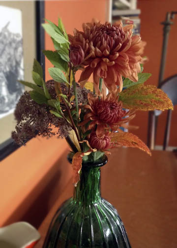 Mums, lacy carrot, and spiraea in a little pear-shaped vase